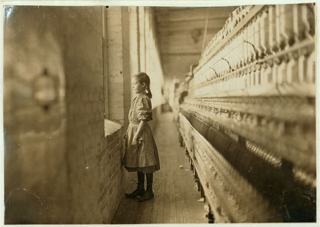 Lewis Hine - Spinner glimpses the outside world (Nov. 11, 1908)