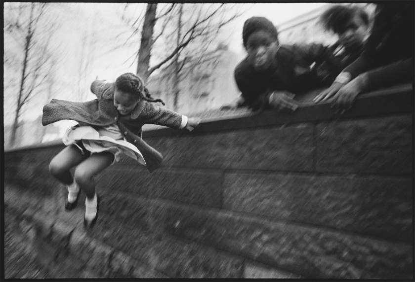 Mary Ellen Mark - Girl jumping over a Wall,  Central Park, New York City, 1967