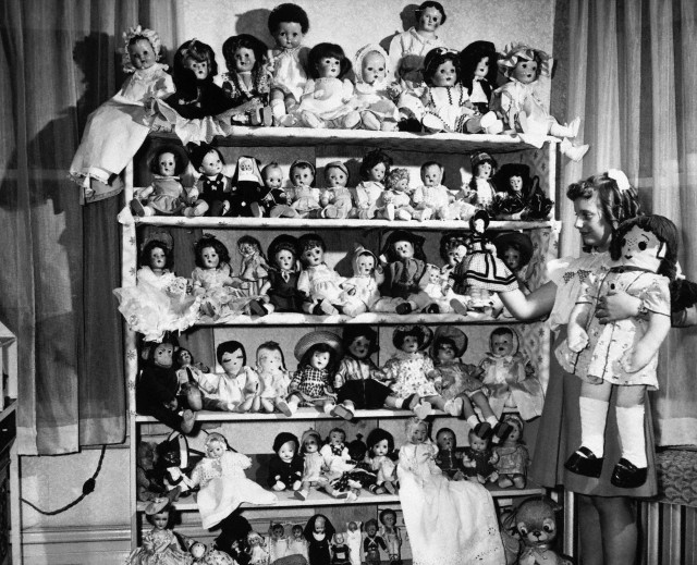 (Photographer Unknown) - A Girl with her Doll Collection (1948)