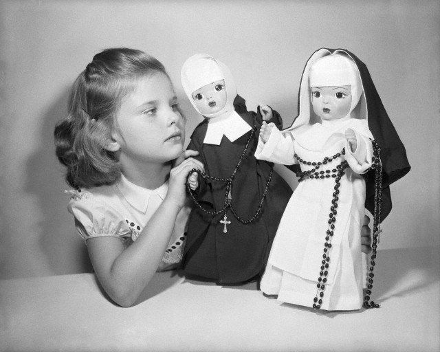(Photographer Unknown) - Girl Playing with Nun Dolls (1953)