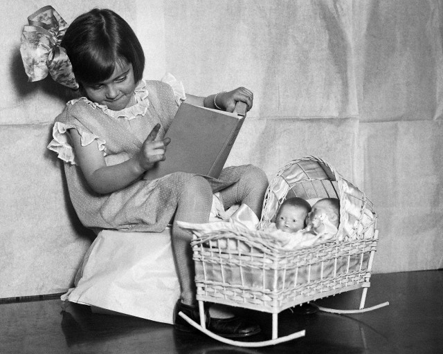 (Photographer Unknown) - Girl Telling Dollies a Bedtime Story (1925)