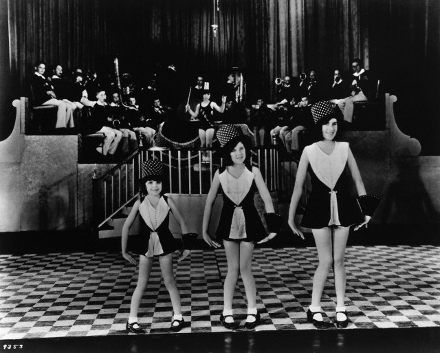 (Photographer Unknown)  - Young Judy Garland with the Gumm Sisters on Stage (1920s)