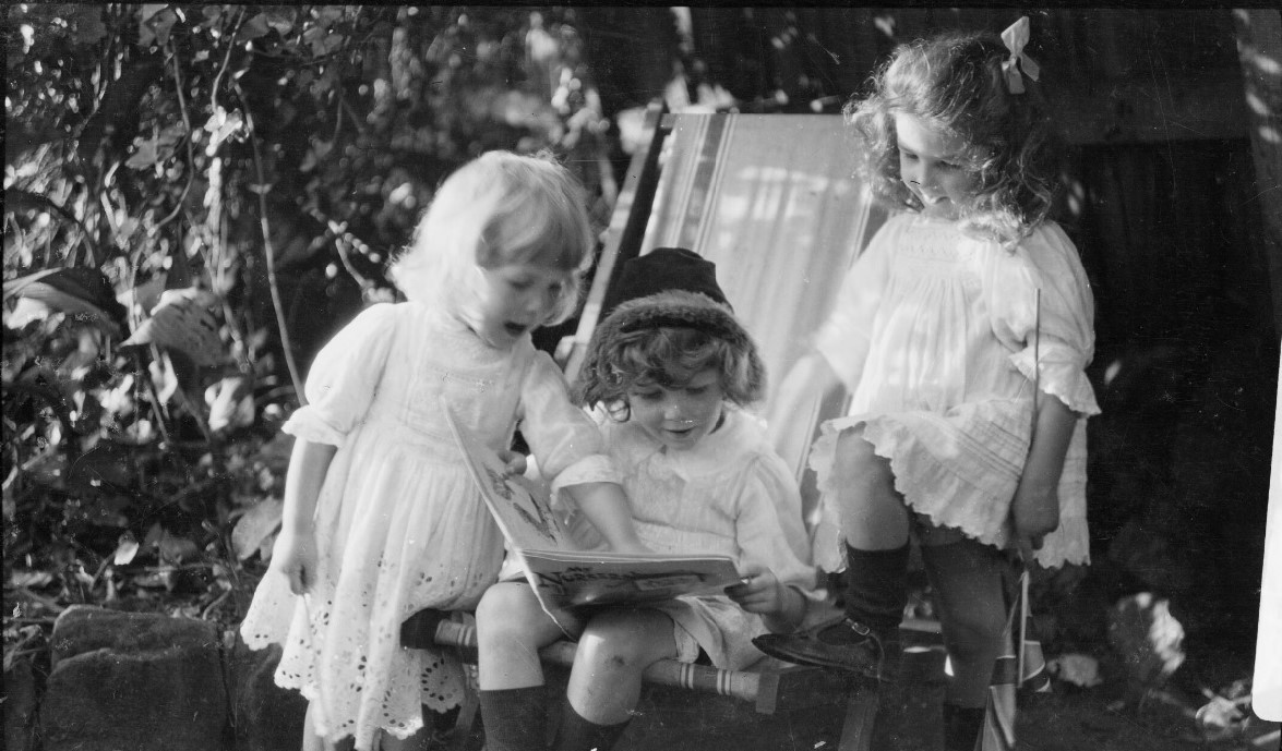 Harold Cazneaux - Beryl, Rainbow and Jean Cazneaux Looking at a Book (1913)